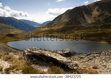 Pedourres lake, Andorra, Pyrenees. Aerial view, Autumn day. - stock photo