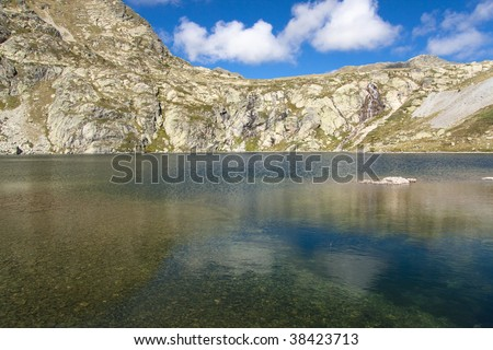 Pedourres lake in Andorra, Pyrenees mountain, summer day - stock photo