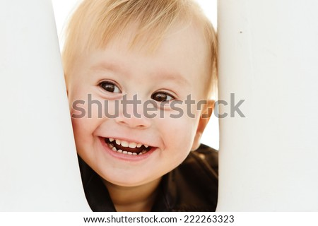 peek a boo - cute baby girl looking out - stock photo