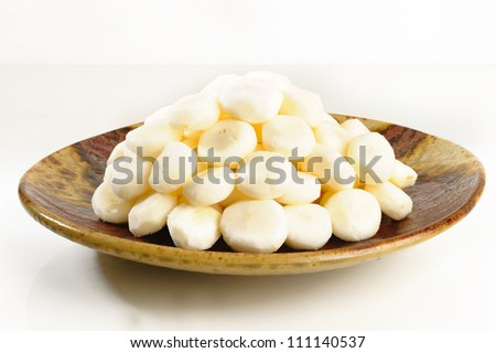 Peel raw chinese water chestnut on dish - stock photo