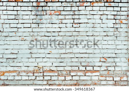 Peeled cold white brick wall texture background. Vintage effect.  - stock photo