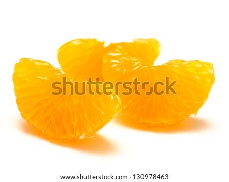 Peeled mandarin orange segments on white background - stock photo