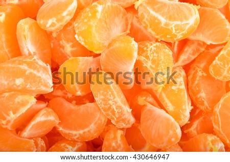 Peeled mandarin segment, close up, as background - stock photo