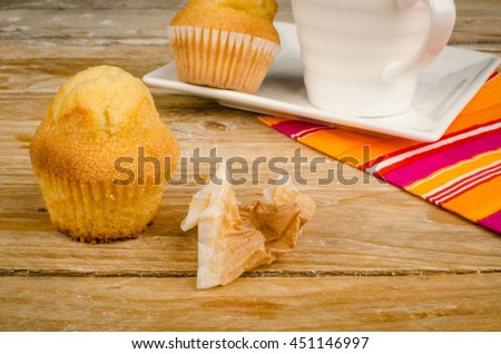 Peeled muffin on a breakfast table - stock photo
