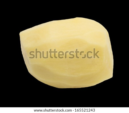 peeled potatoes on a black background - stock photo