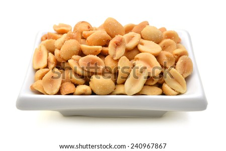 Peeled salted peanuts isolated in white plate on white background  - stock photo
