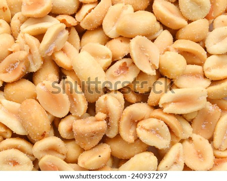 Peeled salted peanuts isolated on  background  - stock photo