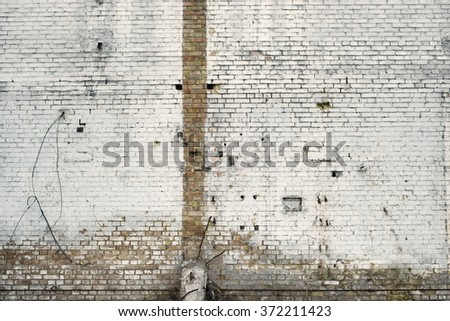 Peeled worn brick wall. Abandoned industrial facility  - stock photo