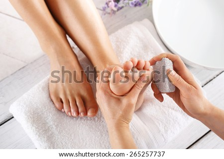 Peeling feet pedicure treatment.Foot care treatment and nail, the woman at the beautician for pedicure. - stock photo