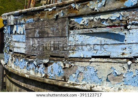 Peeling paint; decaying paintwork on boat hull  - stock photo