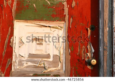 Peeling paint on an old door. - stock photo