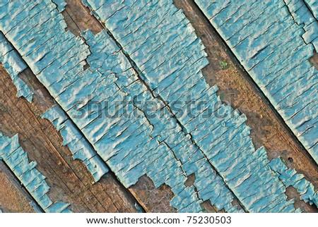 Peeling paint with many cracks on diagonal wood background. - stock photo
