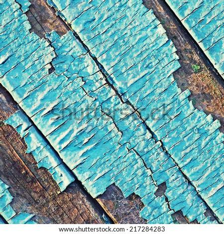 Peeling paint with many cracks on diagonal wood background. square toned image  - stock photo