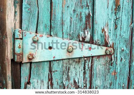 Peeling Turquoise Paint and Hinge - stock photo