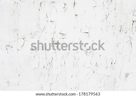 Peeling white cement wall, detail of a wall damaged and abandoned ruin - stock photo
