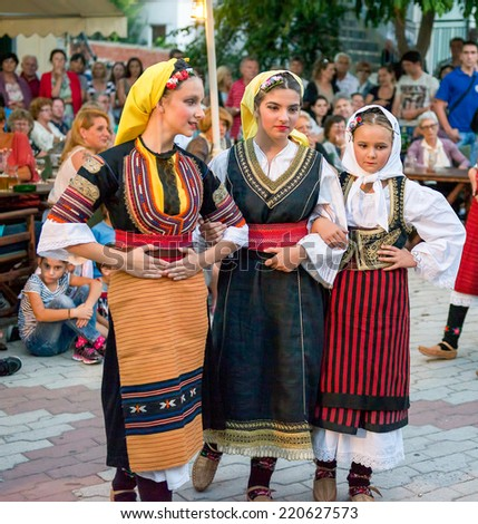 PEFKOHORI , GREECE - SEPTEMBER 19 2014 : Folk Dancers from Serbia taking part in the Annual Folk Dance festival in the village square of Pefkohori ,Greece - stock photo