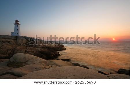 Peggy Cove Lighthouse Sunset, Nova Scotia, Canada - stock photo