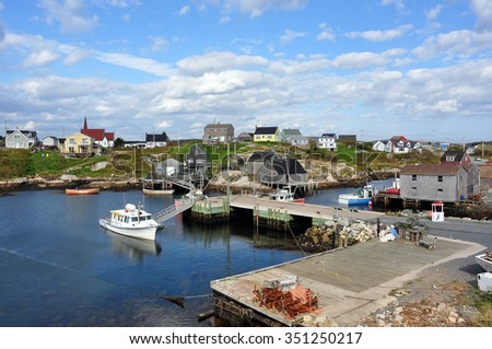 PEGGY'S COVE, CANADA - SEPTEMBER 18, 2009:  Picture showing much of the scenic fishing village which is a famous tourist attraction not far from Halifax, Nova Scotia. - stock photo