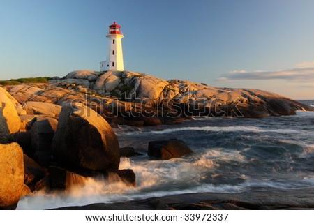 Peggys Cove Lighthouse sunset - stock photo