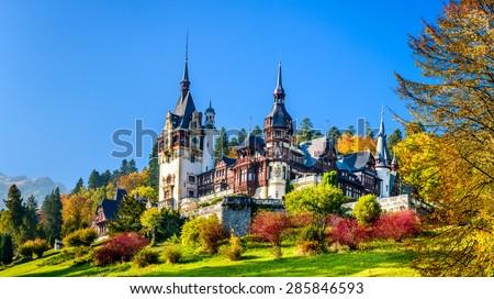 Peles Castle, Romania. Beautiful famous royal castle and ornamental garden in Sinaia landmark of Carpathian Mountains in Europe - stock photo