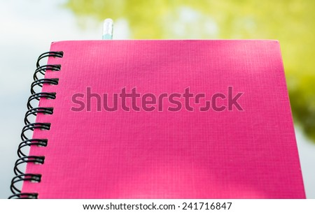pen and a stack of books. Writing material ready to take notes - stock photo