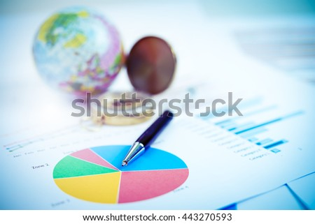 Pen and business graph on the table.Business concept. Vintage filtered. Vintage filtered. - stock photo