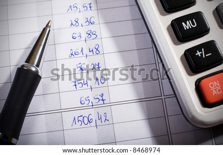 Pen and calculator on financial document. Macro. Shallow DOF. - stock photo