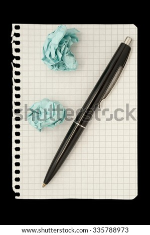 Pen and crumpled papers lying on the background of the sheet into the cell. A composition on a black background - stock photo