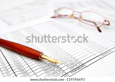 Pen and Glasses. On documents. - stock photo