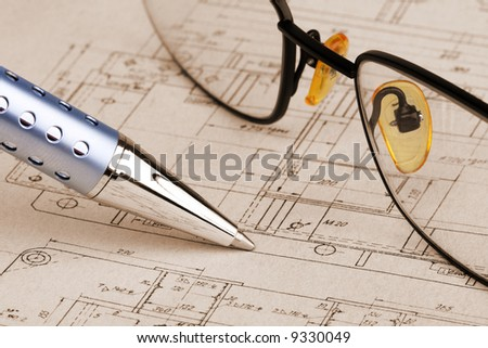 pen and glasses over a blueprint - stock photo