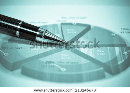 pen and graphs analysis on table. - stock photo