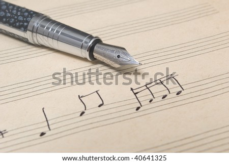 pen and music sheet - musical background - stock photo