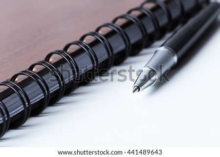 Pen and notebook - stock photo