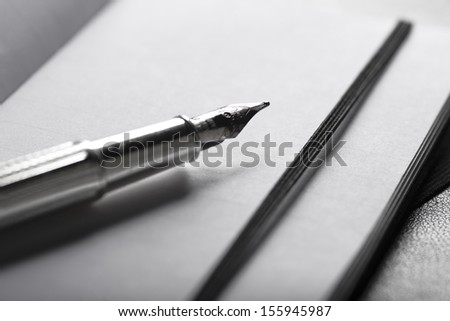 Pen and notebooks - stock photo