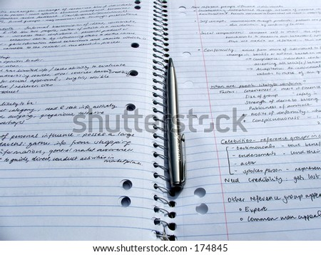 Pen and paper for notetaking - stock photo