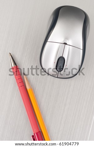 Pen and Pencil with Computer Mouse on Brushed Aluminum - stock photo