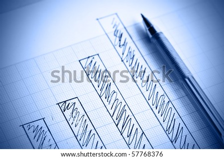 Pen and profit bar chart. Shallow DOF! - stock photo
