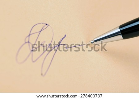 Pen and signature on paper background - stock photo