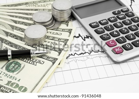 Pen,calculator and dollars on chart closeup. Business concept - stock photo