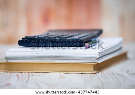 Pen, calculator and notebook  - stock photo