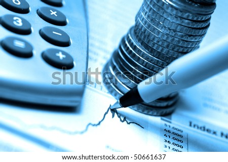 pen, coins and calculator on stock chart, blue tone - stock photo