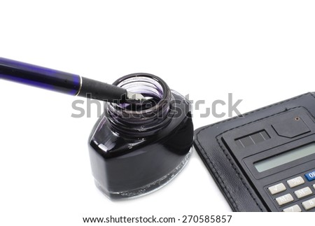 pen deep into ink bottle with calculator isolated white background - stock photo