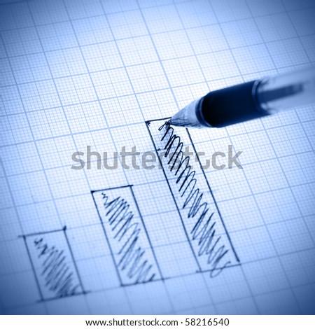 Pen drawing profit bar chart. Shallow DOF! - stock photo