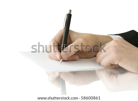 pen in hand writing on the white page with reflection - stock photo