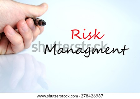 Pen in the hand isolated over white background Risk managment concept - stock photo