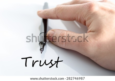 Pen in the hand isolated over white background Trust - stock photo
