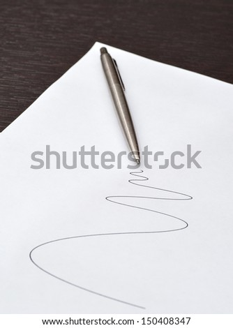 pen lying on a sheet of paper - stock photo