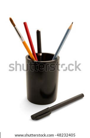 Pen, marker, paintbrush and pencils in pencil holder isolated on white - stock photo