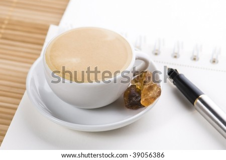 pen, notebook and cup of coffee - stock photo