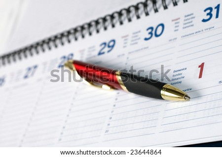 Pen on agenda page with shallow depth of filed - stock photo